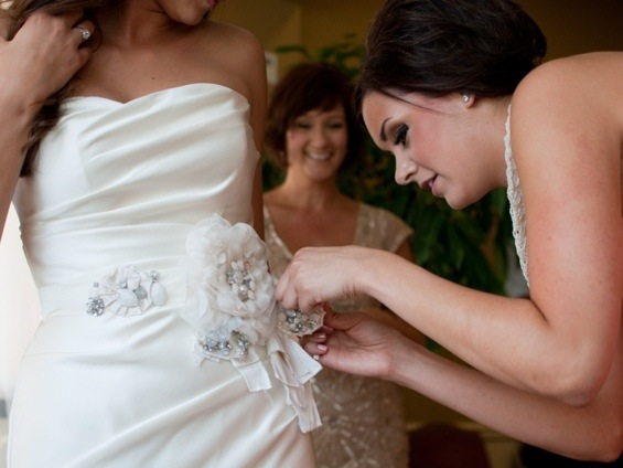 Bride Getting Dressed: Photo by Blair Nicole Photography via Heather Renee Celebrations