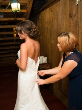 Bride Getting Dressed: Photo by Menning Photographic via Heather Renee Celebrations